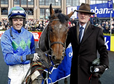 Hurricane Fly is pictured with jockey Ruby Walsh and trainer Willie Mullins following his victory.