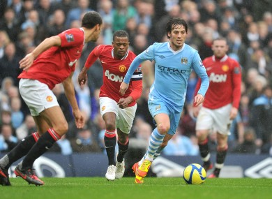David Silva closely guarded by Rio Ferdinand and Patrice Evra.