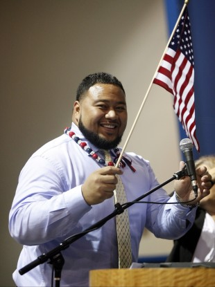 Deuce Lutui, from Tonga, being sworn in as a U.S citizen during a naturalization ceremony in 2010.