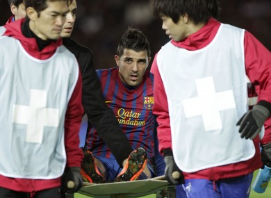 Villa is carried from the pitch in January.