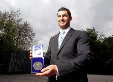 Rob Kearney proudly displays his ERC award.