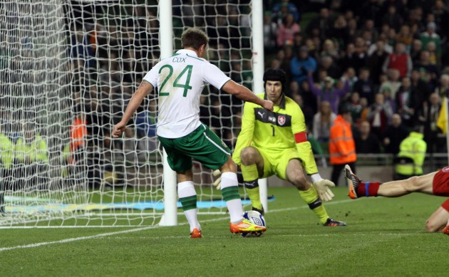 Simon Cox scores past Petr Cech 29/2/2012