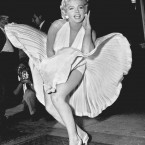 Marilyn Monroe poses over the updraft of a New York subway grating while in character for the filming of
