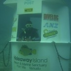 At the worlds first underwater post office, 150 feet out and nine feet down off marine sanctuary Hideaway Island, its not slow-moving lines of humans you have to contend with but schools of shimmering fish.