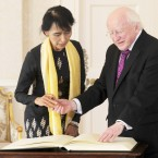 President Michael D Higgins greets Burmese pro democracy leader Aung San Suu Kyi at Aras an Uachtarain this afternoon as part of her visit to Dublin. Photo: Laura Hutton/Photocall Ireland