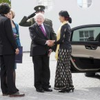 President Michael D Higgins and his wife Sabina say goodbye to Burmese pro democracy leader Aung San Suu Kyi and her son Kim Aris as they leaves Aras an Uachtarain this afternoon on her visit to Dublin. Photo: Laura Hutton/Photocall Ireland