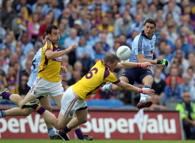Dublin's Bernard Brogan has a shot charged down by Wexford captain David Murphy in last year's Leinster final.