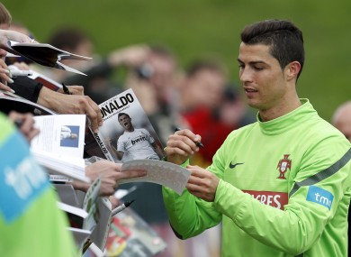 Spotlight: Cristiano Ronaldo signs autographs for fans this week.