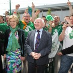 President Michael D Higgins and his wife Sabina meet football fans from Belfast as he arrived to meet the Irish Team at the Sheraton Hotel in Poznan, Poland.