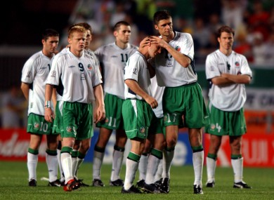 Niall Quinn consoles David Connolly after his missed penalty at the 2002 World Cup.