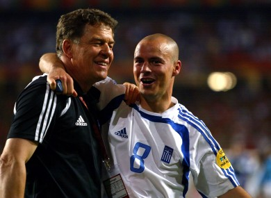 Greece coach Otto Rehhagel celebrates winning the UEFA European Championship with Stylianos Giannakopoulos.