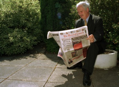 Then Taoiseach John Bruton reads the Meath Chronicle on the newspaper's 100 year anniversary in 1997