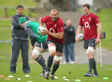 Dan Tuohy charges with the ball in training.