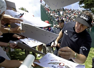 Phil Mickelson signs autographs after a practice round yesterday..