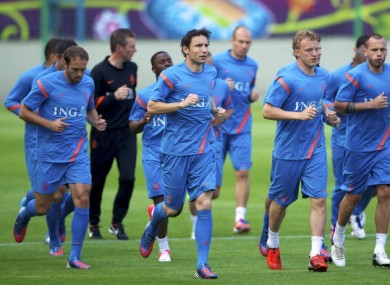 Mark van Bommel leads the Dutch training session.