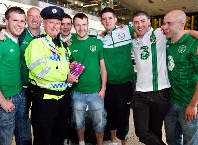 A Dublin Airport police officer with the priceless tickets and Damian's friends before they flew out to Poland earlier this evening.