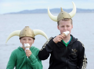 Carl Scully (11) and Connell Molloy (12), both from Clontarf, enjoy the Viking Festival today on the promenade.