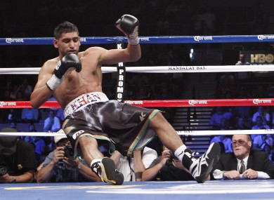 Amir Khan takes his first journey to the canvas in the third round.