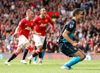 Van Persie reacts to his penalty miss against United last season.
