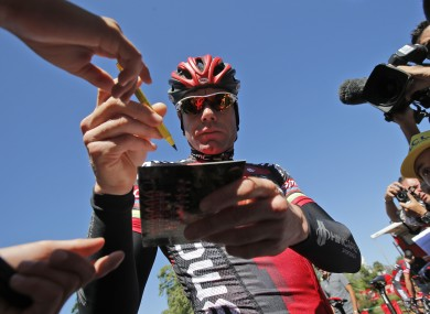 Evans signs autographs after yesterday's stage.