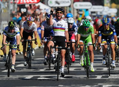 Cavendish crosses the line on the Champs Elysee yesterday.