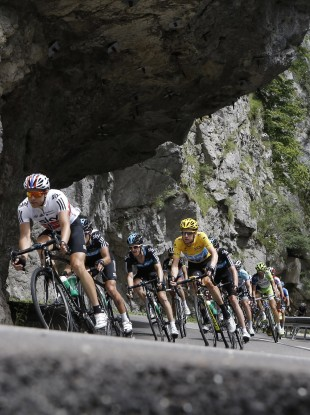Bradley Wiggins follows teammate Edvald Boasson Hagen of Norway, left, as they speed down Granier pass.