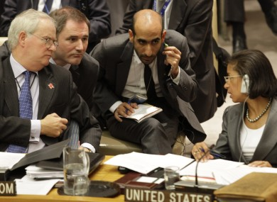 Britain's UN ambassador Mark Lyall Grant speaks with his US counterpart Susan Rice during this afternoon's Security Council meeting.