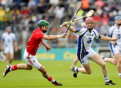 Brian Murphy chases down Waterford's John Mullane.