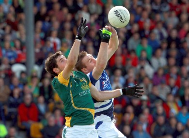 Donal Keoghan of Meath with Colm Kelly of Laois
