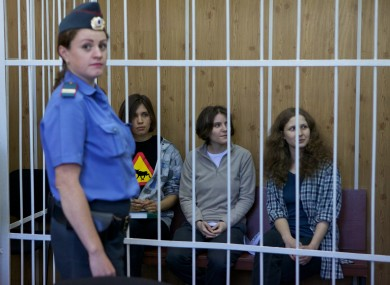 Nadezhda Tolokonnikova, Maria Alekhina and Yekaterina Samutsevich behind bars at the court room in Moscow