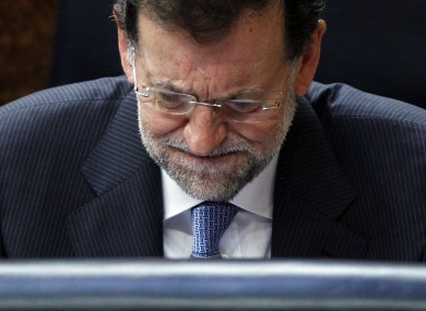 Spain's prime minister Mariano Rajoy is under pressure - but Spain's problems might not be all his own fault.