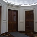 In the interests of symmetry, one of these doors is a fake. Can you guess which one?  