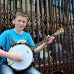 Fifteen-year-old Kevin Holland from Galway making the most of an opportunity to busk during the Fleadh. (Photo: Laura Hutton/Photocall Ireland)