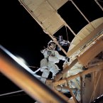 On a spacewalk, astronaut Owen K. Garriott, science pilot, retrieves an imagery experiment from the Apollo Telescope Mount attached to the Skylab in Earth orbit.