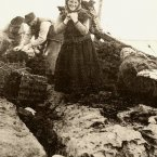 Women wearing traditional clothing at the sea shore