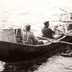 Men ferrying goods on a currach