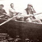 Islanders rowing in a currach.