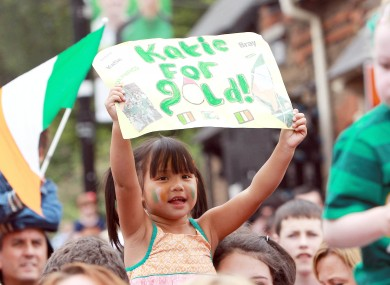 GIRL POWER: A young supporter cheers on Taylor in Bray yesterday.