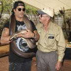 Slash, holding Kalamata, a four-meter olive python. (AP Photo/Tertius Pickard)