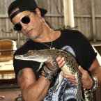 Slash poses with Wickham, a salt water crocodile. (AP Photo/Tertius Pickard)