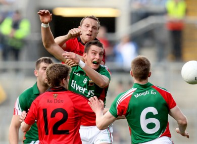 Mayo's Barry Moran and Down's Ambrose Rogers challenging for possession.
