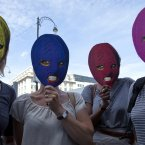 Supporters of the punk band Pussy Riot hold up face masks depicting group members in front of the Russian delegation in Brussels Friday, Aug. 17, 2012. (AP Photo/Virginia Mayo)
