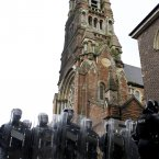 Riot police stand guard outside St Patrick's. (AP Photo/Peter Morrison/PA)