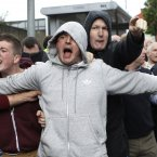 Nationalist protesters react to a loyalist parade outside St Patrick's today. (AP Photo/Peter Morrison/PA)