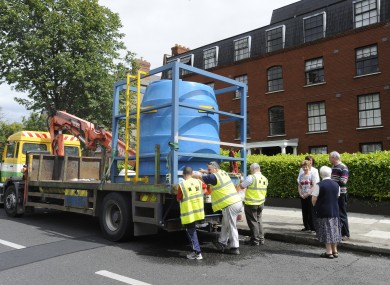A tanker supplies water to residents in Clontarf earlier this week