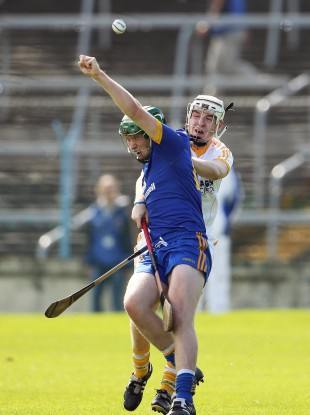 Antrim's Conal Morgan and Cathal McInerney of Clare battle for possession in their U21 All-Ireland semi-final clash.