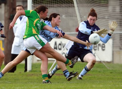 Deirdre Corridon of Kerry tries a shot on goal as Joanne O'Sullivan and Cliodhna Clarke of Dublin close in.