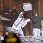 Youths throw objects at riot police during the first night of the summer riots in Tottenham, London.