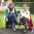 Two of EP2012's 200 volunteers, Cliodhna Dillon from Waterford and Lucy McCron from Donegal, take a load off. (Photo: Alf Harvey)