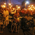 Survivors of the 1984 Bhopal gas tragedy participate in a torch rally to protest against the sponsorship of the London Paralympics 2012 by Dow Chemicals, in Bhopal, India. (AP Photo/Rajeev Gupta)